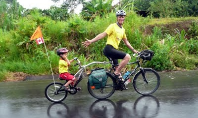 Steven Tober and his son Ramon cycling in the Ecuadorian Amazon.