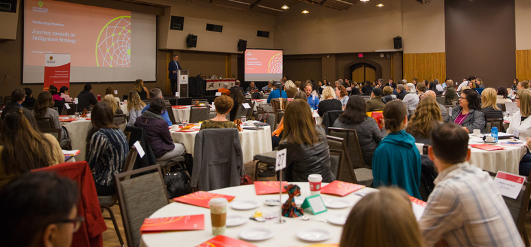 Brian Calliou, director for The Banff Centre's Indigenous Leadership and Management program area — and master of ceremonies for the on-campus stakeholder dialogue session — welcomes a full turnout of participants. Photos by Riley Brandt, University of Calgary